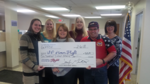 Gladstone staff presents a donation to the U.P. Honor Flight from Dress Down donations and member donations from Veteran's Day