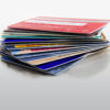 Stack of colorful credit cards on reflective surface